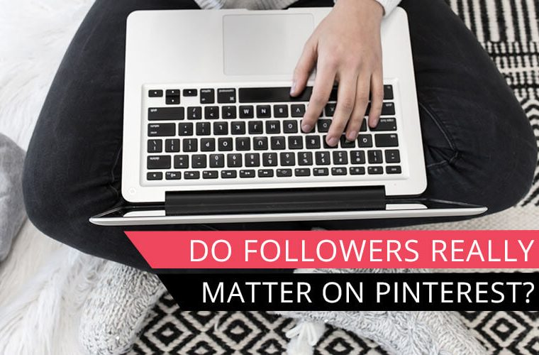 overhead view of woman sitting on floor with laptop and text overlay do followers really matter on pinterest