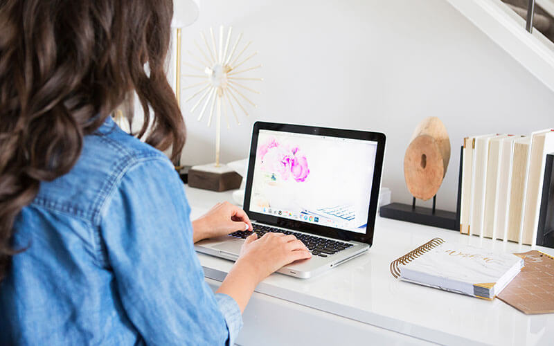 woman at computer installing wordpress plugin