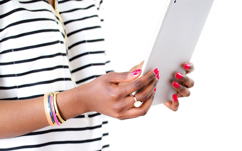 woman holding tablet