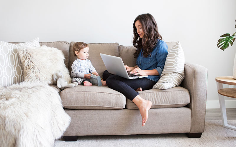 mom working at computer starting a blog with son