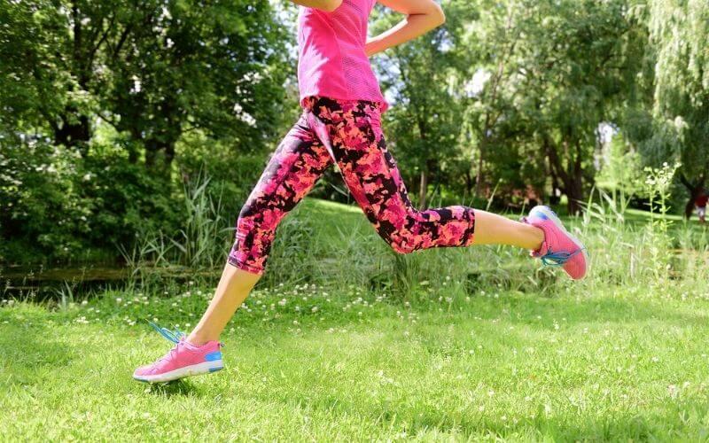 woman running in capri leggings