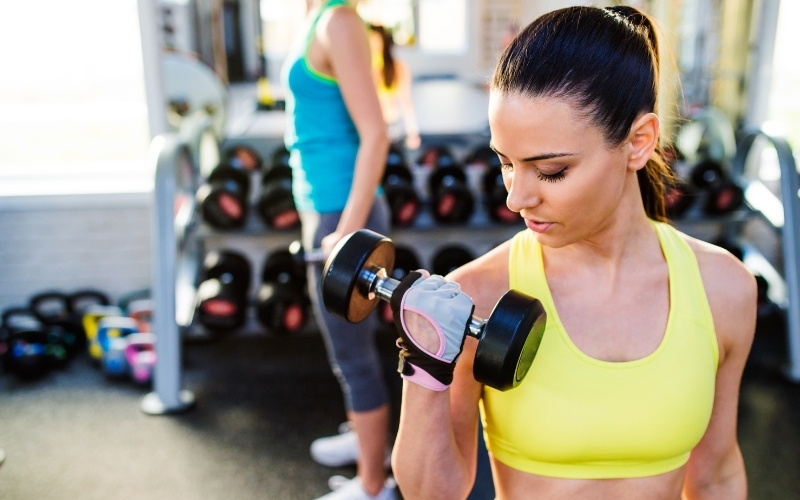 Woman working out in gym wearing a sports bra