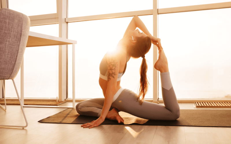 woman wearing yoga pants holding yoga pose